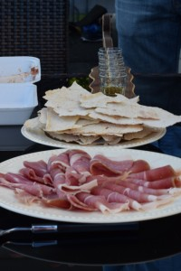 Proscuitto, potato crisps, and aquavit