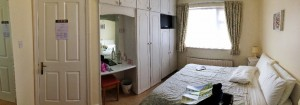 This is our B&B room.  Can you find the bathroom?  It is through the wardrobe doors!
